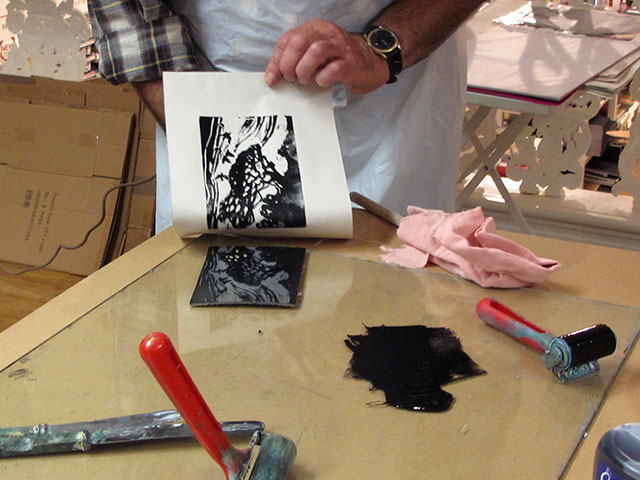 4. Carefully peel off the paper from the inky lino.