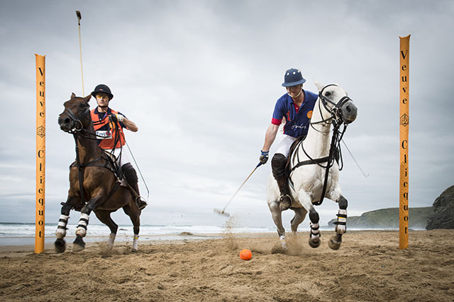 Ben Marshall rides pony Reina (left) and Rob Brockett rides pony Torda (right) as they practise ahead of Polo on the Beach 2014. This year's free event will take place at Watergate Bay from 26 to 28 June 2015. Images may be used free of charge subject to the following conditions: 1) The image is used in publicity or editorial material promoting GWR Polo on the Beach or Watergate Bay Hotel, provided the use of each image is strictly non-commercial. 2) The photographer is credited as indicated above. 3) Images may not of themselves be used to generate income, nor be sold, or given, for use to third parties.